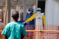 A health worker dressed in a protective suit talks to medical staff at the newly constructed MSF <HIT>Ebola</HIT> treatment centre in Goma