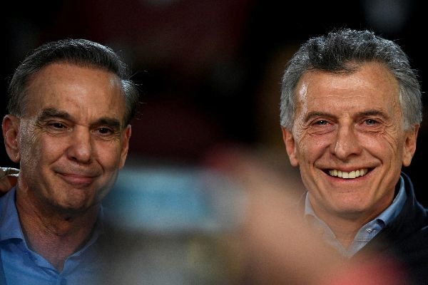 Argentine President Mauricio Macri poses next to his running mate...