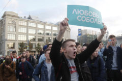 A participant shouts slogans during a procession following a rally to demand authorities allow opposition candidates to run in a local election in Moscow