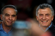 Argentine President Mauricio Macri poses next to his running mate Miguel Angel Pichetto, during a closing campaign rally ahead of primary elections, in <HIT>Buenos</HIT> <HIT>Aires</HIT>