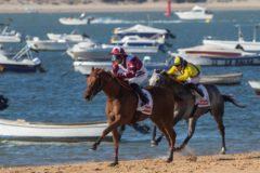 Una de las carreras celebradas este sábado en la playa de Sanlúcar.
