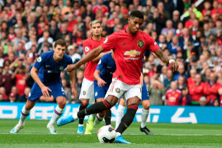 Manchester United's English striker Marcus <HIT>Rashford</HIT> (C) shoots to score from the penalty spot for the opening goal during the English Premier League football match between Manchester United and Chelsea at Old Trafford in Manchester, north west England, on August 11, 2019. (Photo by Oli SCARFF / AFP) / RESTRICTED TO EDITORIAL USE. No use with unauthorized audio, video, data, fixture lists, club/league logos or 'live' services. Online in-match use limited to 120 images. An additional 40 images may be used in extra time. No video emulation. Social media in-match use limited to 120 images. An additional 40 images may be used in extra time. No use in betting publications, games or single club/league/player publications. /