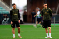 "(FILES) In this file photo taken on May 28, 2019 Arsenal's German midfielder Mesut <HIT>Ozil</HIT> (L) and Arsenal's German-born Bosnian defender Sead Kolasinac (R) attend a training session at the Baku Olympic Stadium in Baku on May 28, 2019 on the eve of the UEFA Europa League final football match between Chelsea and Arsenal. - Two men will appear in court next month charged with a public order offence, police confirmed on August 11, 2019, in connection with two Arsenal footballers previously targeted in an attack. Arsenal said Mesut <HIT>Ozil</HIT> and Sead Kolasinac would not play in Sunday's opening English Premier League fixture at Newcastle due to ""further security incidents"". (Photo by OZAN KOSE / AFP)"