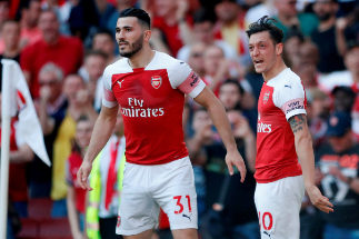 FILE PHOTO: Soccer Football - Premier League - Arsenal v Crystal Palace - Emirates Stadium, London, Britain - April 21, 2019 Arsenal's Mesut <HIT>Ozil</HIT> celebrates scoring their first goal with Sead Kolasinac Action Images via Reuters/Matthew Childs/File Photo NO RESALES. NO ARCHIVES
