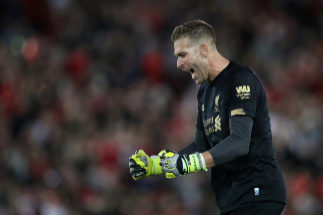 """FILE PHOTO: Soccer Football - Premier League - <HIT>Liverpool</HIT> v Norwich City - Anfield, <HIT>Liverpool</HIT>, Britain - August 9, 2019 <HIT>Liverpool</HIT>'s <HIT>Adrian</HIT> celebrates after the match Action Images via Reuters/Carl Recine EDITORIAL USE ONLY. No use with unauthorized audio, video, data, fixture lists, club/league logos or """"live"""" services. Online in-match use limited to 75 images, no video emulation. No use in betting, games or single club/league/player publications. Please contact your account representative for further details./File Photo"""