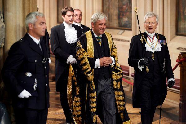 Gentleman Usher of the Black Rod David Leakey (R) walks with Speaker...