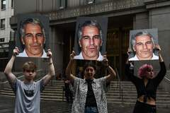 """(FILES) In this file photo taken on July 8, 2019, A protest group called """"Hot Mess"""" hold up signs of Jeffrey <HIT>Epstein</HIT> in front of the Federal courthouse in New York City. - Two more women have filed a USD 100 million lawsuit against the estate of Jeffrey <HIT>Epstein</HIT>, accusing the tycoon of having sexually abused them 15 years ago. The age of the accusers was not listed in the lawsuit, but their lawyer Lisa Bloom said in a statement on August 16, 2019 they were 18 and 20 at the time of the alleged abuse. (Photo by STEPHANIE KEITH / GETTY IMAGES NORTH AMERICA / AFP)"""
