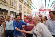 Juan Manuel Moreno, durante su visita este viernes a la Feria de Málaga.
