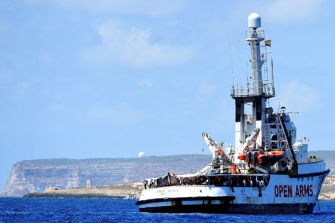 Spanish migrant rescue ship <HIT>Open</HIT> <HIT>Arms</HIT> is seen close to the Italian shore in Lampedusa