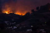 Flames and smoke from a forest fire are seen in the village of Moya on the Canary Island of Gran <HIT>Canaria</HIT>