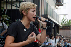 Hong Kong pro-democracy singer <HIT>Denise</HIT> <HIT>Ho</HIT> performs at a free concert after Lancome, the face-cream company owned by French cosmetics giant L'Oreal, cancelled a concert featuring <HIT>Ho</HIT>, in Hong Kong, China June 19, 2016. REUTERS/Bobby Yip - S1AETKTXEPAA