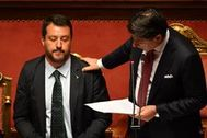 "TOPSHOT - Italian Prime Minister Giuseppe <HIT>Conte</HIT> (R) touches Deputy Prime Minister and Interior Minister Matteo Salvini's shoulder as he delivers a speech at the Italian Senate, in Rome, on August 20, 2019, as the country faces a political crisis. - Italy's Premier <HIT>Conte</HIT> says to offer resignation during his speech at the Senate after calling Italy's far-right Interior Minister Matteo Salvini ""irresponsible"" to spark a political crisis by pulling the plug on the governing coalition. (Photo by Andreas SOLARO / AFP)"