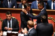 Rome (Italy).- Italian Prime Minister Giuseppe Conte (C) is hugged by Deputy Prime Minister and Labour Minister Luigi <HIT>Di</HIT> <HIT>Maio</HIT> (R) after addressing the Senate in Rome, Italy, 20 August 2019. Conte in his address to the senate called bringing about the government crisis irresponsible. Deputy Premier and Interior Minister Matteo Salvini and his party League pulled out from government and caused a political crisis a week ago. Conte said that the government has come to an end and that he would resign. (Italia, Roma) EPA/