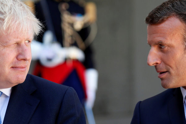 French President Emmanuel Macron and British Prime Minister Boris...