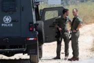 Soldados israelíes enel lugar del ataque, en Cisjordania.