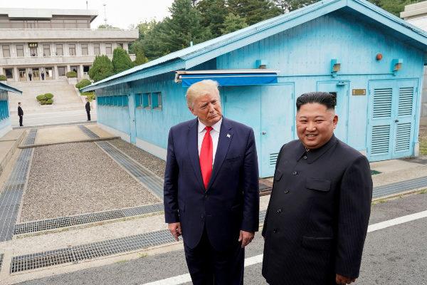 FILE PHOTO: FILE PHOTO: Trump meets with North Korean leader...