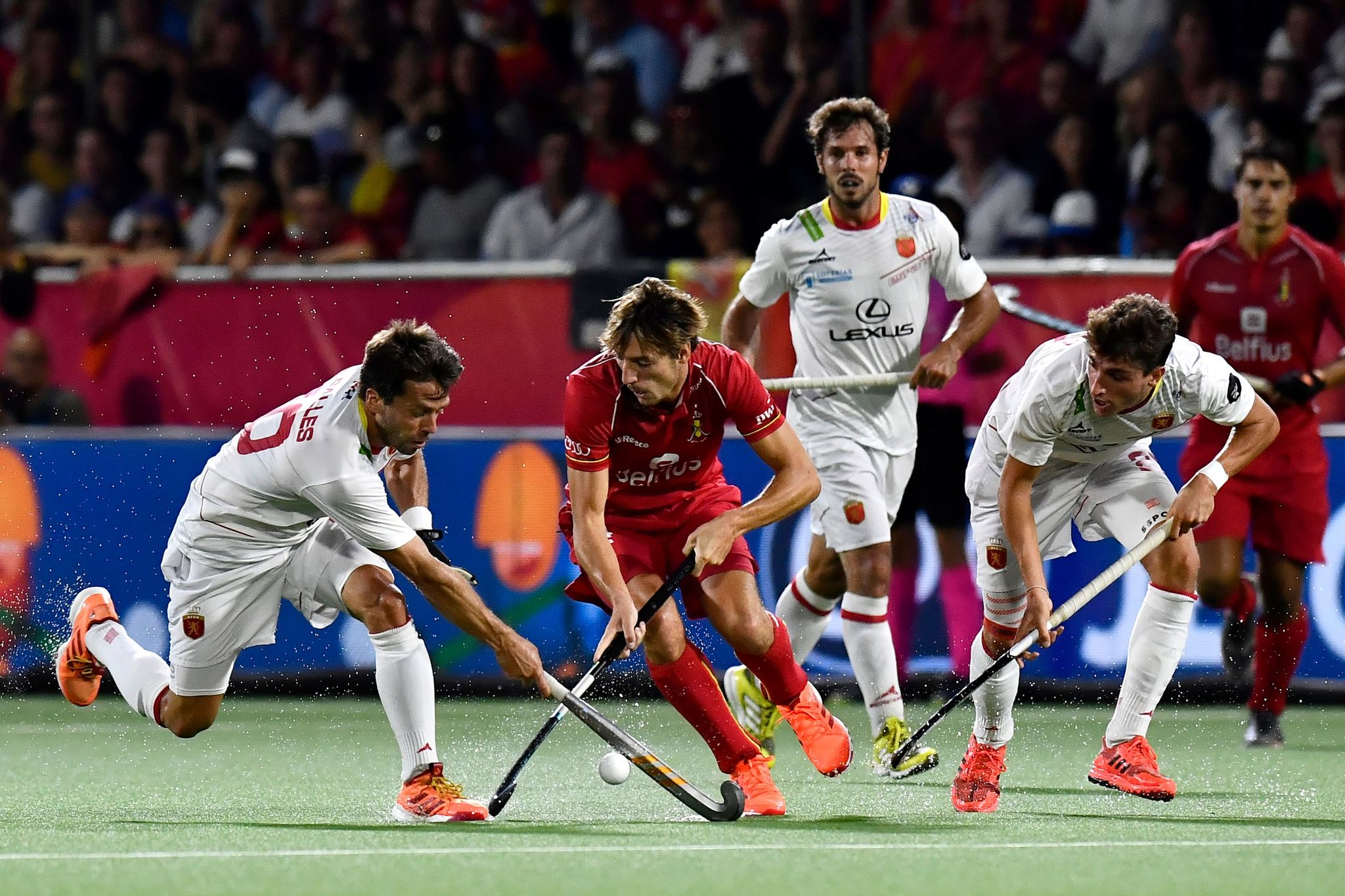Spain's Marc Salles and Belgium's Antoine Kina vie during the 'EuroHockey' European Championships <HIT>hockey</HIT> match finals between Belgian national team The Red Lions and Spain, on August 24, 2019 in Wilrijk, Antwerp. (Photo by DIRK WAEM / BELGA / AFP) / Belgium OUT