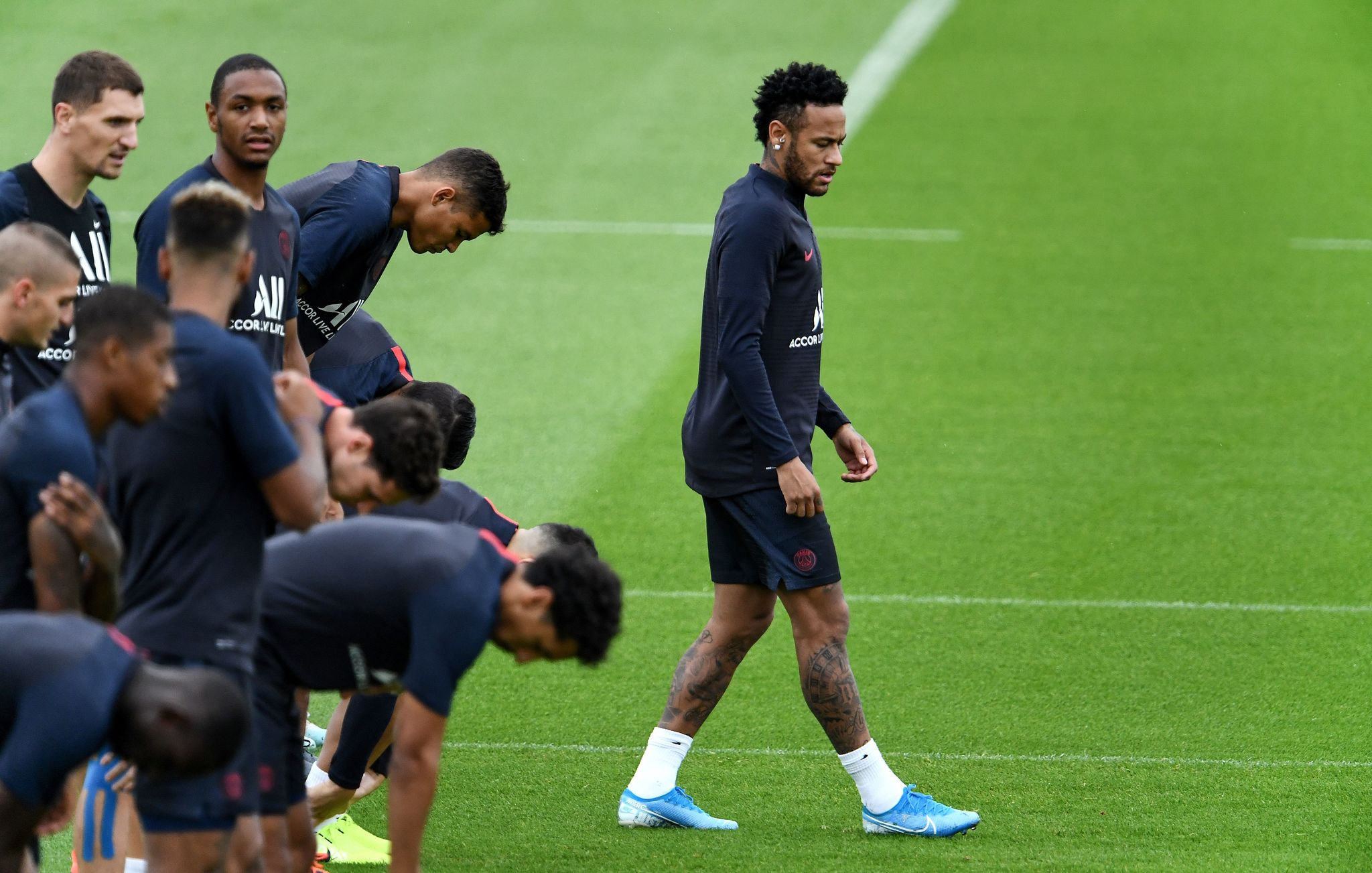 """(FILES) In this file photo taken on August 17, 2019 Paris Saint-Germain's Brazilian forward <HIT>Neymar</HIT> takes part in a training session in Saint-Germain-en-Laye, west of Paris, on the eve of the French L1 football match between Paris Saint-Germain (PSG) and Rennes. - Paris Saint-Germain coach Thomas Tuchel said <HIT>Neymar</HIT> is """"ready"""" for the upcoming Ligue 1 game but whether he plays depends on developments in the Brazilian's bid to leave the club. (Photo by FRANCK FIFE / AFP)"""