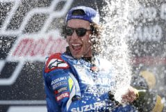 Suzuki Ecstar's Spanish rider Alex <HIT>Rins</HIT> sprays champagne on the podium as he celebrates his victory in the Moto GP race of the British Grand Prix at Silverstone circuit in Northamptonshire, central England, on August 25, 2019. - Alex <HIT>Rins</HIT> won the British MotoGP in dramatic fashion as the Team Suzuki rider pipped world champion Marc Marquez to the finish line by 0.013 seconds at Silverstone on Sunday. (Photo by Adrian DENNIS / AFP)