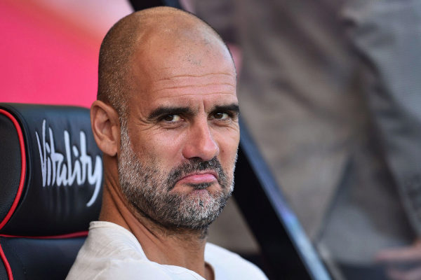 Manchester City&apos;s Spanish manager Pep <HIT>Guardiola</HIT> looks on...