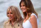 U.S. First Lady <HIT>Melania</HIT> Trump (R) poses with <HIT>Brigitte</HIT> Macron (R), wife of the French President during a meeting with surfers at the Cote des Basques beach, in Biarritz, south-western France, on August 26, 2019, on the third and final day of the annual G7 summit. (Photo by Julien DE ROSA / POOL / AFP)
