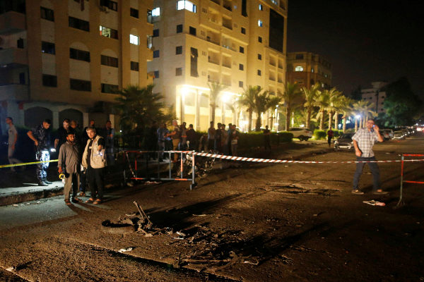 Palestinians check the scene following an explosion in <HIT>Gaza</HIT>...