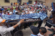 Tizert (Morocco).- Mourners attend the funeral of three flood in Tizert, Morocco, 29 August 2019. At least seven people were killed on 28 August 28 during flash floods when a river burst its banks and flooded a village football pitch where a game was being played in south Morocco, local authorities said. (Inundaciones, <HIT>Marruecos</HIT>) EPA/