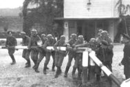 Kolibki (<HIT>Poland</HIT>), 01/09/1939.- A handout photo made available by National Digital Archive <HIT>Poland</HIT> shows German propaganda staging of Members of Gdansk Police formations pretending to break the barrier at the border crossing between <HIT>Poland</HIT> and the free City of Gdansk, during Invasion of <HIT>Poland</HIT> (also September Campaign) in Kolibki, <HIT>Poland</HIT>, 01-14 September 1939 (issued 23 August 2019). September 2019 sees the 80th anniversary of the start of World War II in Europe with the German Wehrmacht invading <HIT>Poland</HIT>. Based of staged false and faked incidents to justify the attack, German troops on 01 September 1939 broke through border crossings and attacked the neighboring country's fortified Military Transit Depot on the Westerplatte peninsula in the Bay of Danzig with joint naval, army and air forces. The political and military events following resulted in a worldwide war from 1939 to 1945 that cost the lives of up to 85 million people, many of them unrecorded civilians, who died of diseases