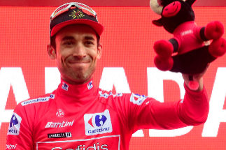 Team Cofidis rider France's Nicolas <HIT>Edet</HIT>, wearing the leader?s red jersey, celebrates on the podium after the eighth stage of the 2019 La Vuelta cycling tour of Spain, a 166,9 km race from Valls to Igualada on August 31, 2019 in Igualada. (Photo by JOSE JORDAN / AFP)