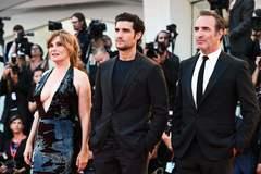 Emmanuelle Seigner, Louis Garrel y Jean Dujardin, este viernes en Venecia.