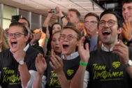 Christian Democratic Union (CDU) supporters react after first exit polls for the Saxony state election in Dresden
