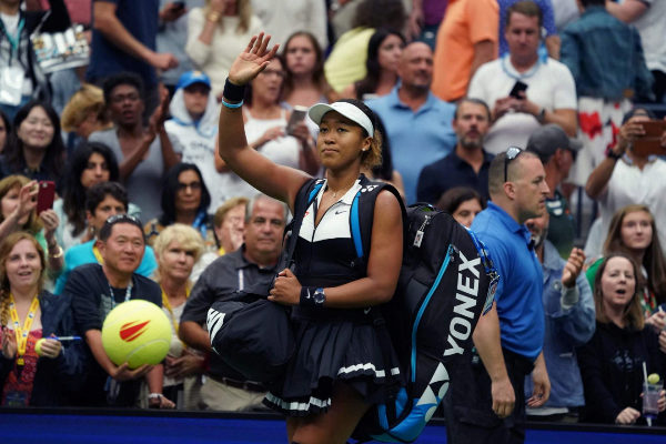Naomi <HIT>Osaka</HIT> of Japan looks on after loosing against Belinda...