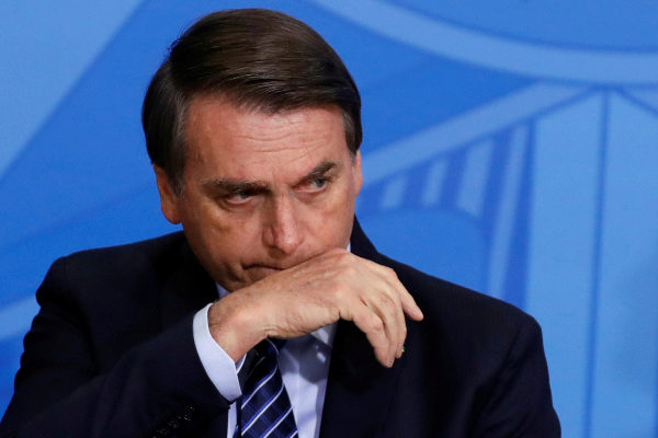 Brazil&amp;apos;s President Jair <HIT>Bolsonaro</HIT> reacts during a launching...