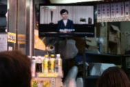 Customers at an eatery watch a live television broadcast showing Hong Kong Chief Executive <HIT>Carrie</HIT> <HIT>Lam</HIT> formally withdrawing a controversial extradition bill in Hong Kong on September 4, 2019. - Hong Kong's embattled pro-Beijing leader announced September 4 she will permanently shelve a loathed extradition bill that lit the fuse for three months of pro-democracy protests which have plunged the city into crisis. (Photo by Anthony WALLACE / AFP)