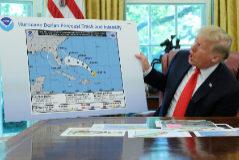 U.S. President <HIT>Trump</HIT> receives a Hurricane <HIT>Dorian</HIT> update at the White House in Washington