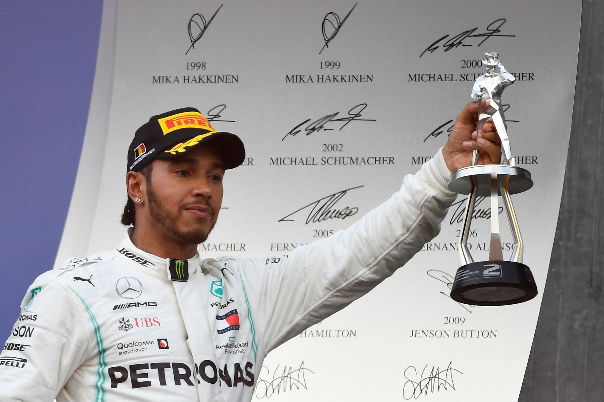 Second placed Mercedes' British driver Lewis <HIT>Hamilton</HIT> celebrates with his trophy on the podium after the Belgian Formula One Grand Prix at the Spa-Francorchamps circuit in Spa on September 1, 2019. (Photo by JOHN THYS / AFP)