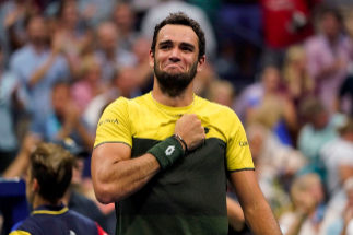 Matteo <HIT>Berrettini</HIT> from Italy celebrates his win over Gael Monfils from France during their Men's Singles Quarterfinals match at the 2019 US Open at the USTA Billie Jean King National Tennis Center in New York on September 4, 2019. (Photo by Kena Betancur / AFP)