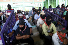 Members of the indigenous <HIT>Zapatista</HIT> National Liberation Army (EZLN) take part in the National Indigenous Congress in San Cristobal de las Casas, Chiapas, Mexico May 27, 2017. REUTERS/Violeta Schmidt - RC1AB399EB60