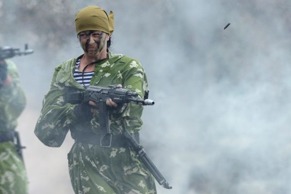 Russian female soldier performs during a rehearsal for the Navy Day...