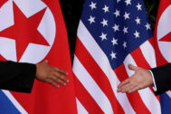 FILE PHOTO: U.S. President Trump and North Korea's <HIT>Kim</HIT> meet at the start of their summit in Singapore