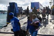 Desembarco de evacuados por el huracán Dorian en Nassau.