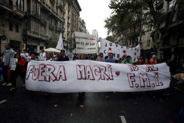 FILE PHOTO: Argentine unions, small firms and activists march near...