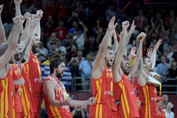Spanish players celebrate on the podium after their team's win against...