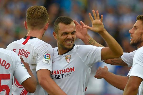 <HIT>Sevilla</HIT>&amp;apos;s Spanish midfielder Joan Jordan (C) celebrates...