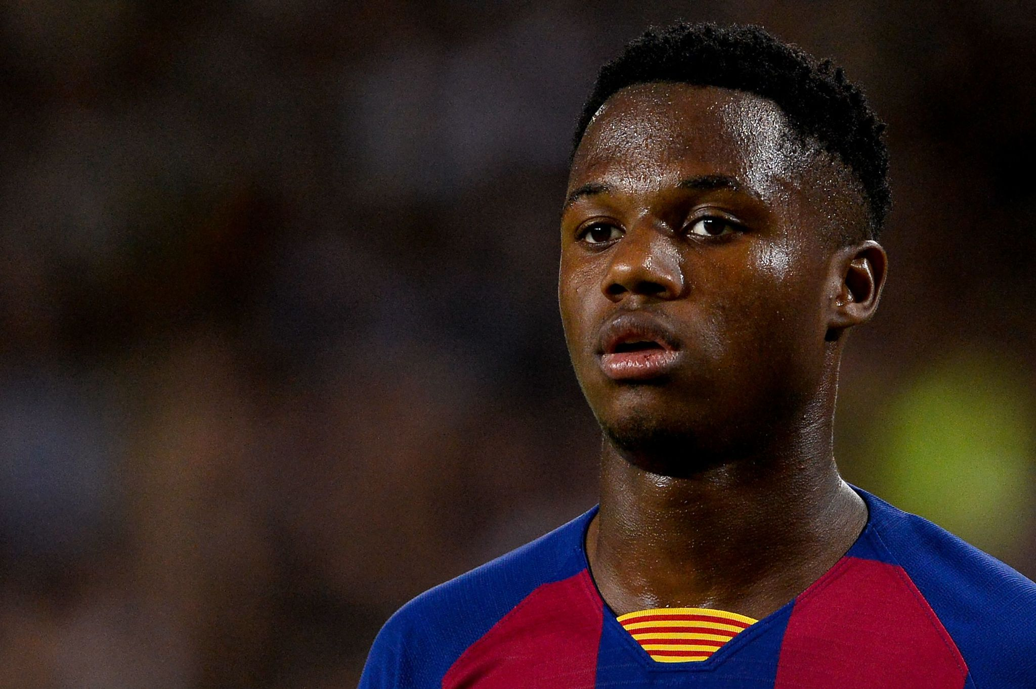 Barcelona?s Guinea-Bissau forward <HIT>Ansu</HIT> <HIT>Fati</HIT> looks on during the Spanish league football match FC Barcelona against Valencia CF at the Camp Nou stadium in Barcelona on September 14, 2019. (Photo by PAU BARRENA / AFP)