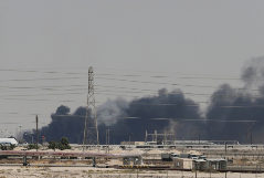 Smoke is seen following a fire at <HIT>Aramco</HIT> facility in the eastern city of Abqaiq