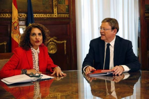 María Jesús Montero y Ximo Puig.