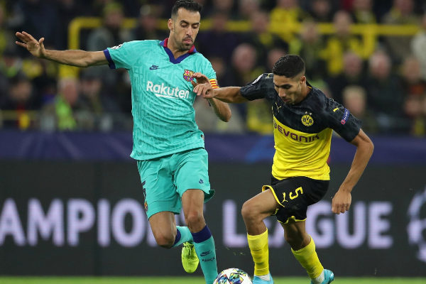 Dortmund (Germany).- Dortmund's Achraf Hakimi (R) in action against...