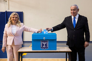 FILE PHOTO: Israeli Prime Minister Benjamin Netanyahu and his wife Sara casts their votes during <HIT>Israel</HIT>'s parliamentary election at a polling station in Jerusalem