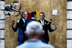 Rome (Italy).- People walk past the latest mural by Italian artist Tvboy displaying Pd secretary Nicola Zingaretti, premier Giuseppe Conte and FM minister Luigi Di Maio while Matteo <HIT>Renzi</HIT> as Cupido and shoot her arrow, in downtown Rome, Italy, 06 September 2019. (Italia, Roma) EPA/